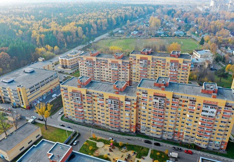 Фото белой новостройки новосибирск в районе ауры были цифровыми